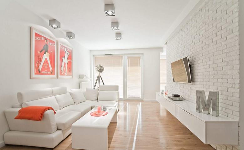 Biała cegła na ścianie w salonie, źródło: Boho Studio