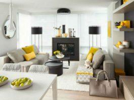 Żółte dodatki w pokoju dziennym ożywiają wnętrze